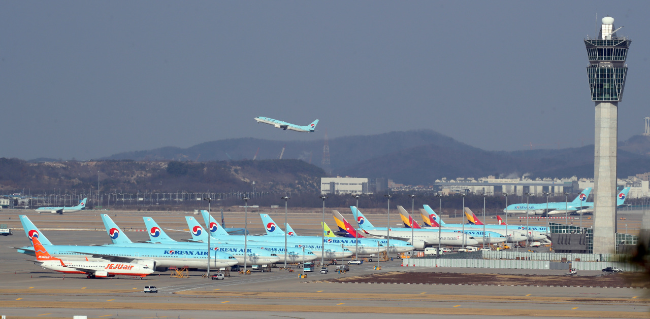 Aircrafts are stationed at a parking ramp inside Incheon International Airport. (Yonhap)