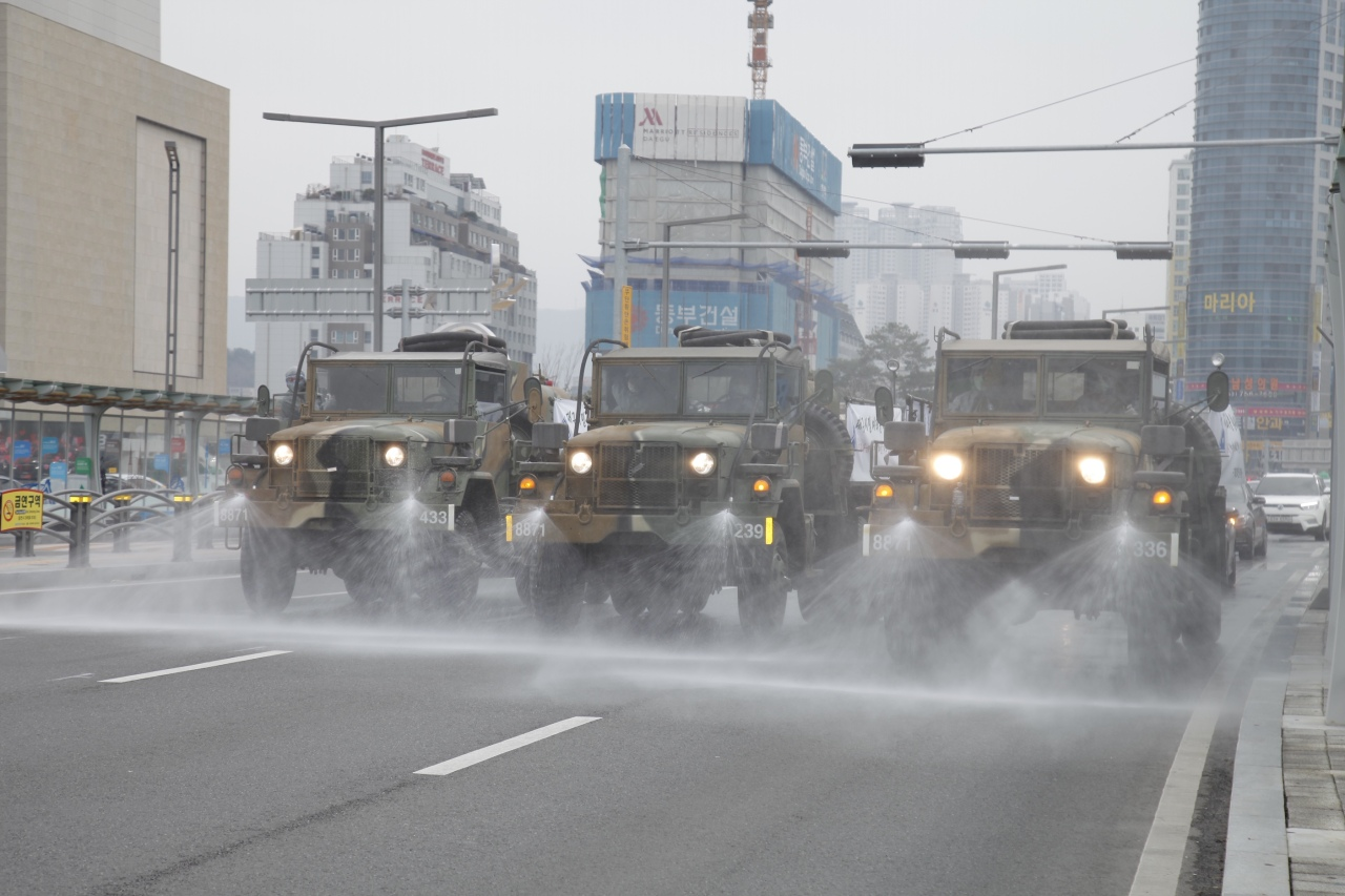 Army vehicles disinfect and sanitize roads in the southeastern city of Daegu, the area hit hardest by the COVID-19 epidemic, Feb. 29. (Army)