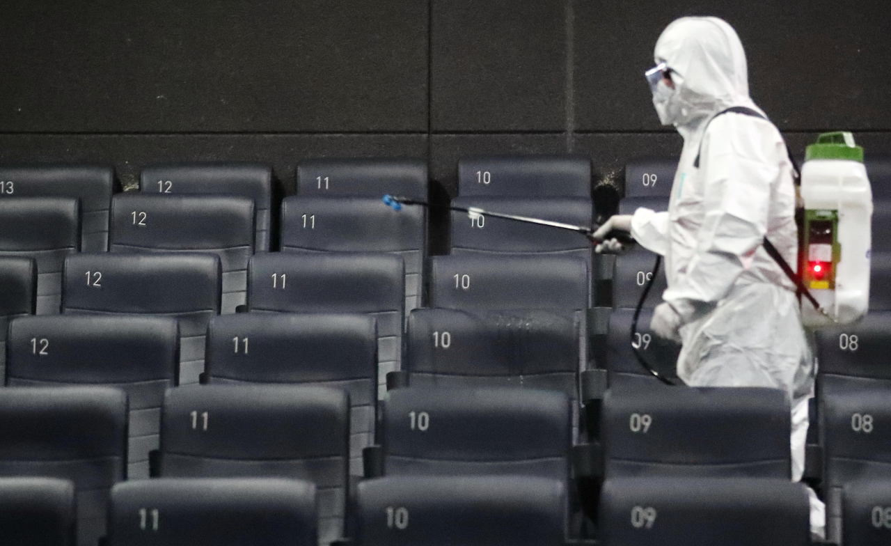 A quarantine official disinfects a cinema located in Gwangjin-gu, Seoul, on Feb. 26. (Yonhap)