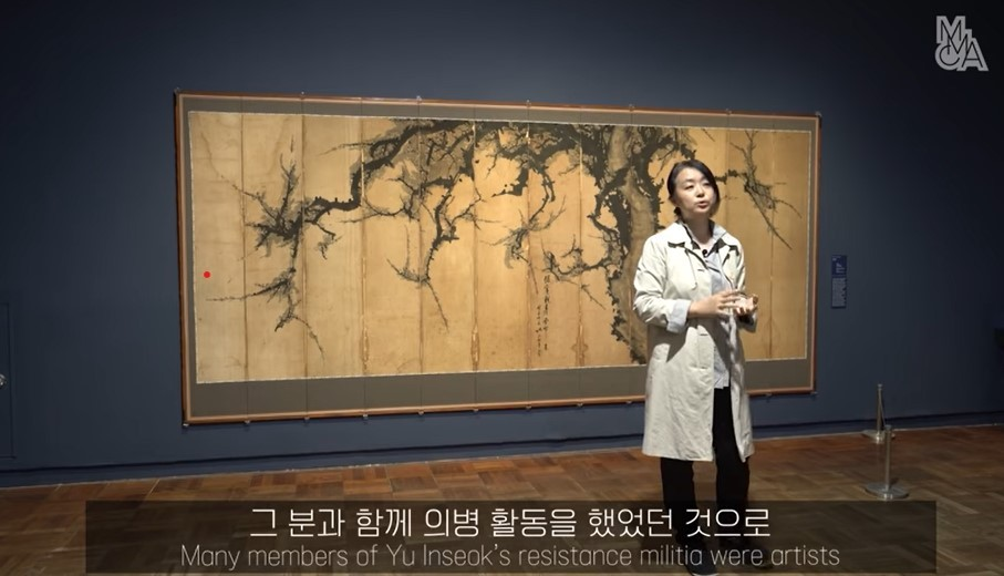 "Kim In-hye, a curator at the MMCA, showcases ""The Square: Art and Society in Korea"" through a live gallery tour. (MMCA YouTube)"