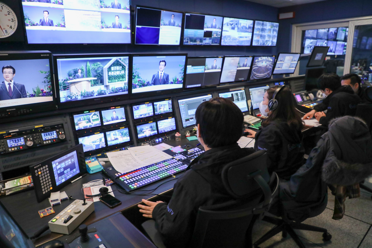 The broadcasting team of Sarang Church live are seen streaming Sunday service on Sunday. (Sarang Church)