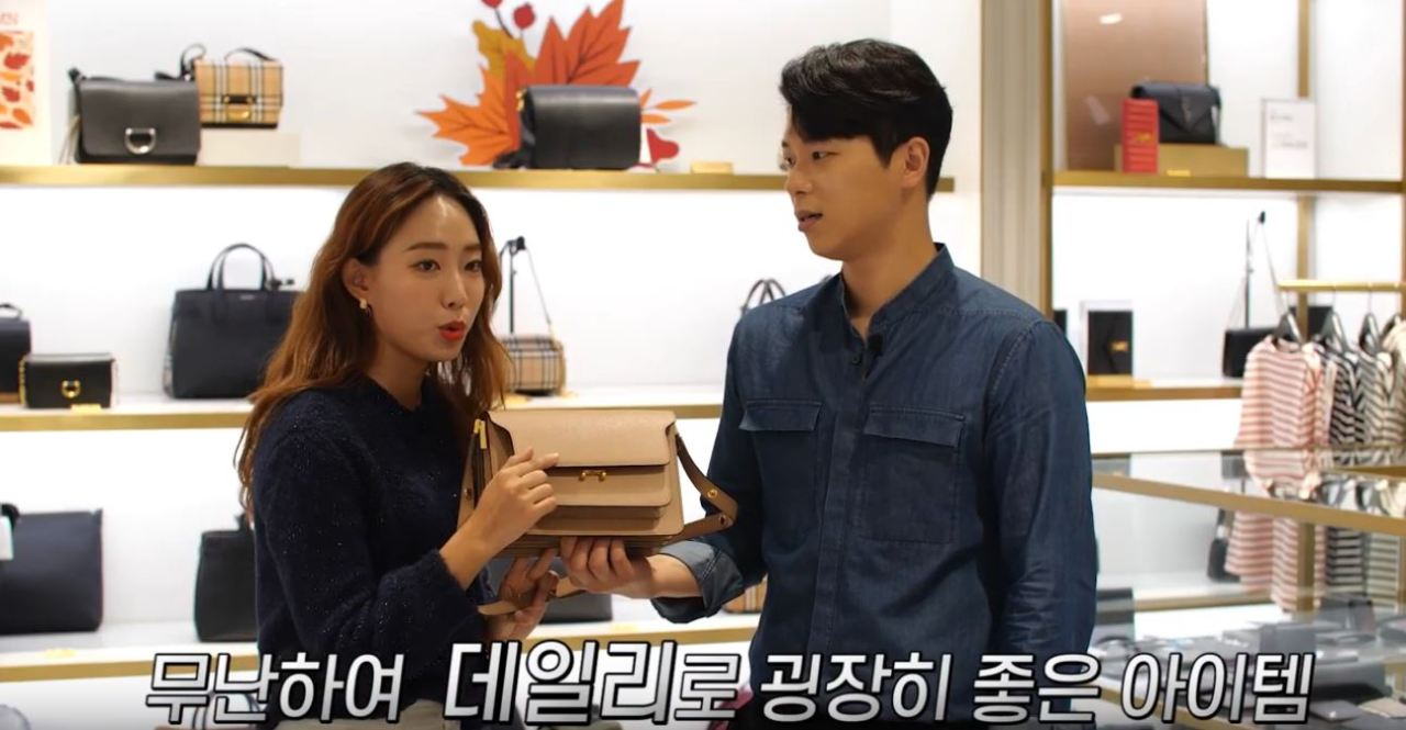Show hosts promote a bag on a livestream. (Lotte Department Store)