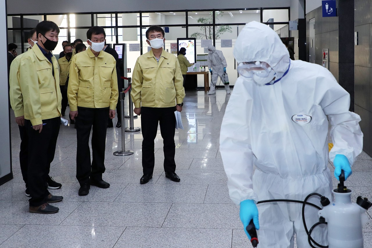Disinfection is underway at the government complex in Sejong on Thursday. (Yonhap)