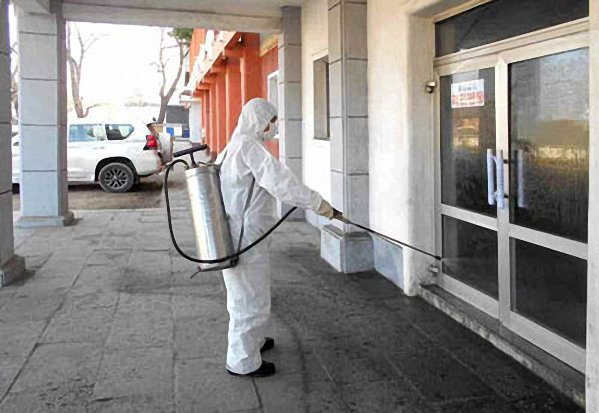 A North Korean official is spraying disinfectant somewhere in North Hwanghae Province south of the capital city of Pyongyang. (Yonhap)