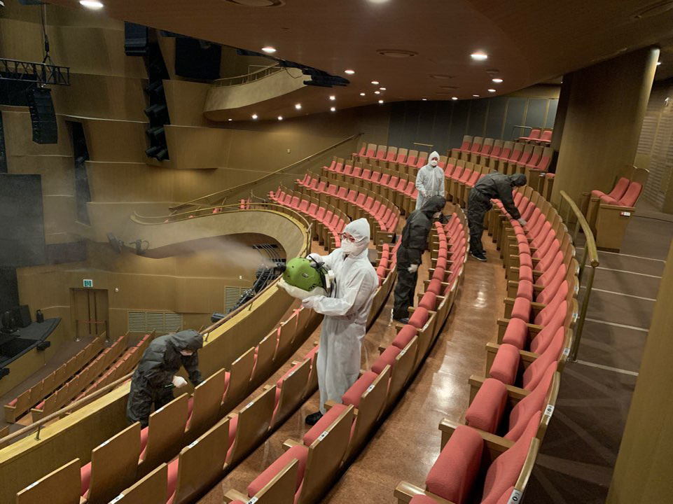 Workers wearing protective gear disinfect the concert hall at the Seoul Arts Center. (Seoul Arts Center)