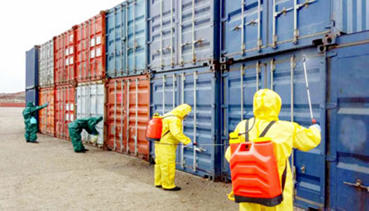 North Korean officials decontaminate shipments at its largest container port in the west-coast city of Nampo on March 9. (Yonhap)