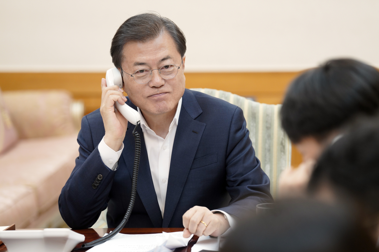 South Korean President Moon Jae-in speaks over the phone with US President Donald Trump on Tuesday. (Yonhap)