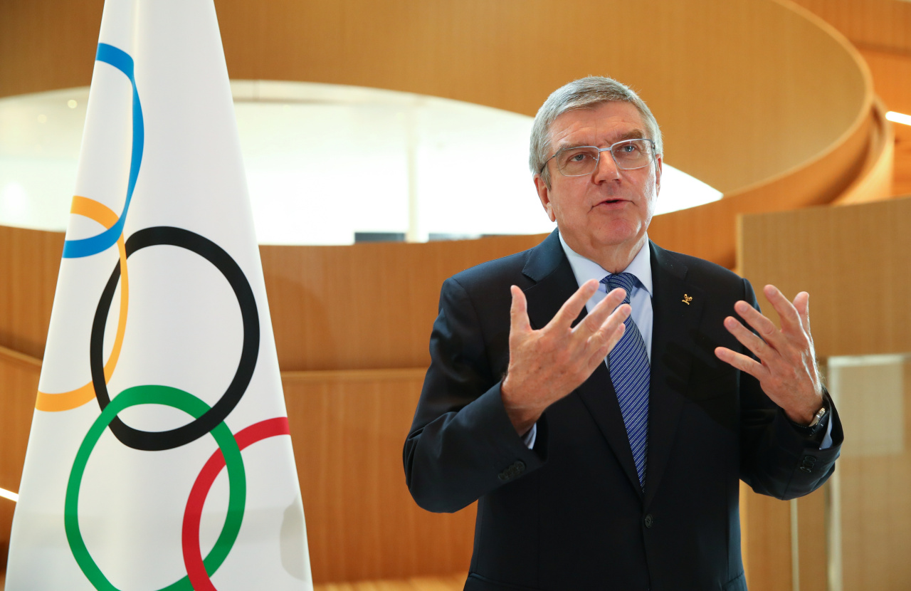 International Olympic Committee (IOC) President Thomas Bach attends an interview after after the historic decision to postpone the 2020 Tokyo Olympic Games due to the coronavirus pandemic, in Lausanne, Switzerland, on March 25, 2020. (AFP-Yonhap)