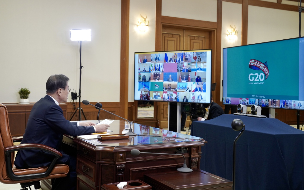 South Korean President Moon Jae-in speaks during a teleconference with G-20 leaders amid the coronavirus outbreak. (Yonhap)