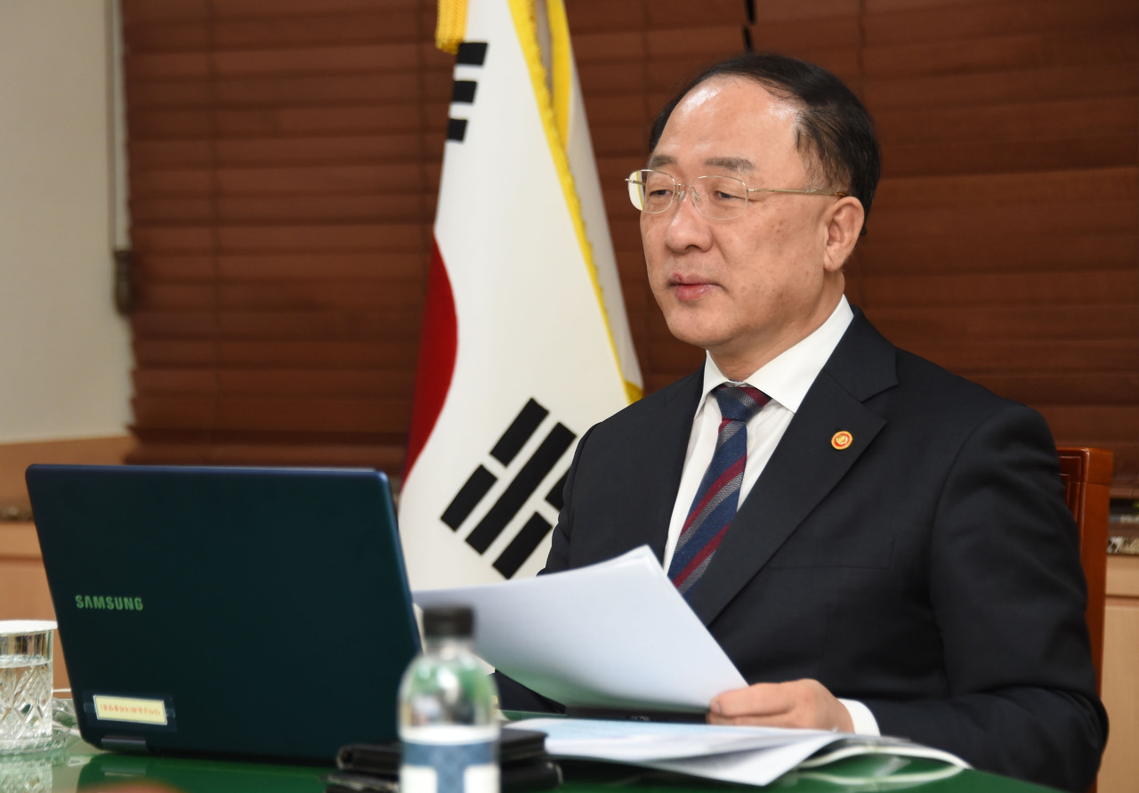 Finance Minister Hong Nam-ki attends a video conference of the International Monetary and Financial Committee Friday. (The Ministry of Strategy and Finance)