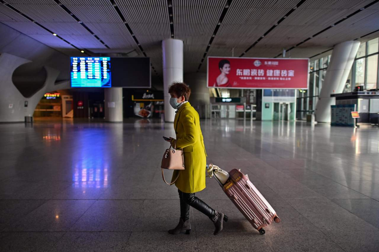 A woman wearing a face mask is seen at the railway station in Wuhan, China's central Hubei province on Saturday after travelling restrictions into the city were eased following two months of lockdown due to the COVID-19 coronavirus outbreak. - The Chinese city of 11 million people that was Ground Zero for what became the global coronavirus pandemic partly reopened on Saturday after more than two months of almost total isolation. (AFP)