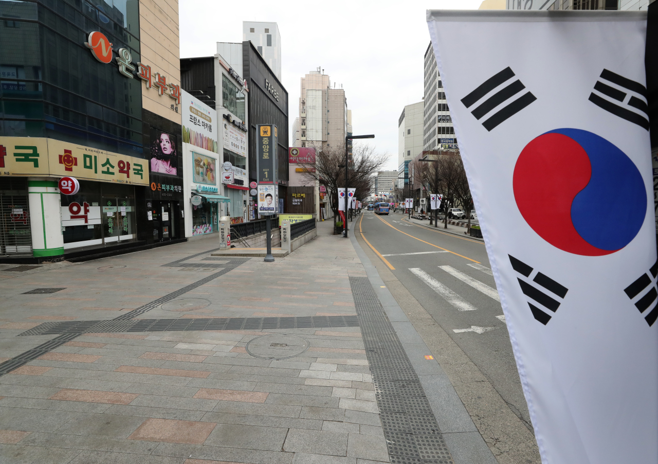 The streets of downtown Daegu are unusually quiet on March 1 amid the COVID-19 pandemic. The city had reported the highest number of novel coronavirus infections among the 17 major administrative areas in Korea as of March 28. (Yonhap)