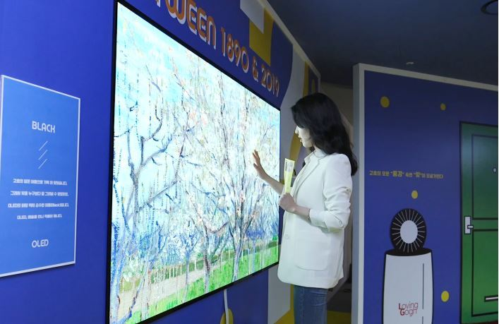 """A high-end TV is showcased at a gallery in downtown Seoul in April 2019 in a collaboration between tech and art under the theme """"Meet Vincent van Gogh."""" Korean tech firms' marketing, buoyed bya series of sports events, will likely be vitalized for up to 20 months between 2021 and 2022. (LG Electronics)"""