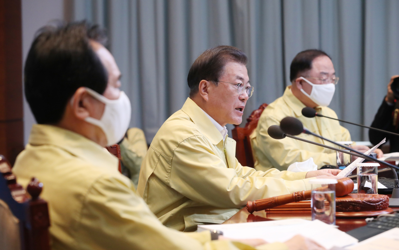 President Moon Jae-in speaks at the Cabinet meeting on Tuesday. Yonhap