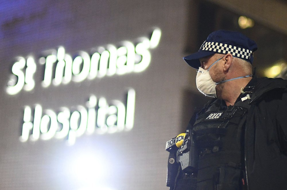 A police officer stands outside St Thomas' Hospital in central London as British Prime Minister Boris Johnson was moved to intensive care after his coronavirus symptoms worsened on Monday April 6, 2020. Johnson was admitted to St Thomas' hospital in central London on Sunday after his coronavirus symptoms persisted for 10 days. Having been in hospital for tests and observation, his doctors advised that he be admitted to intensive care on Monday evening. (AP)