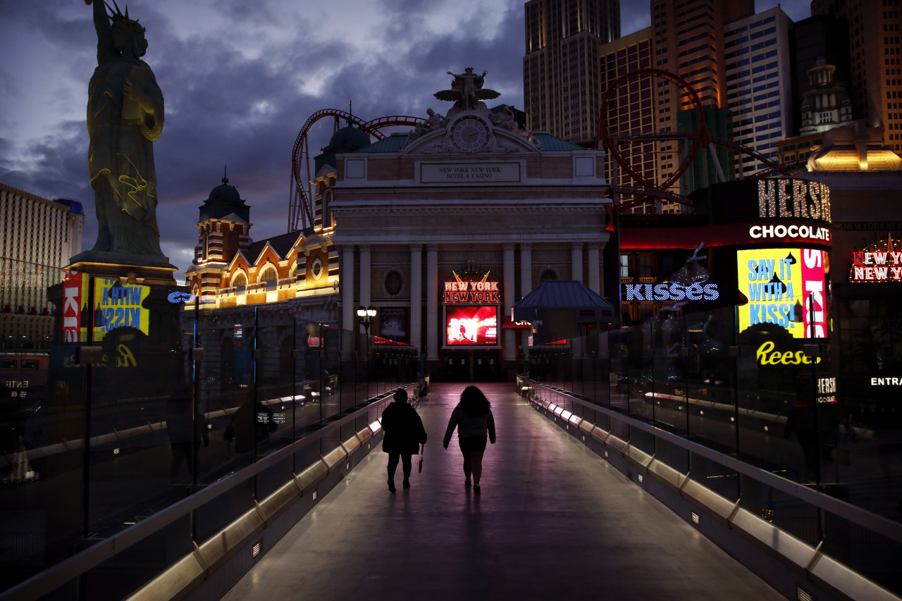 As Nevada authorities ordered casinos closed for the first time amid the COVID-19 outbreak, the Las Vegas Strip is deserted on March 18. (AP-Yonhap)