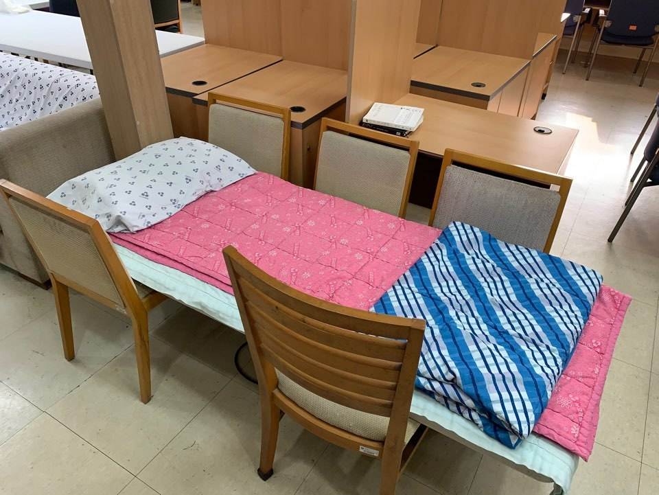 Medical staffers have improvised a bed using chairs to be used while on the night shift. (courtesy of nurse)