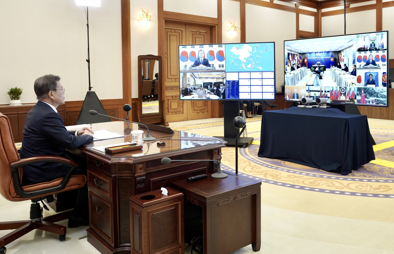 President Moon Jae-in participates in the ASEAN+3 teleconference on Tuesday. (Yonhap)