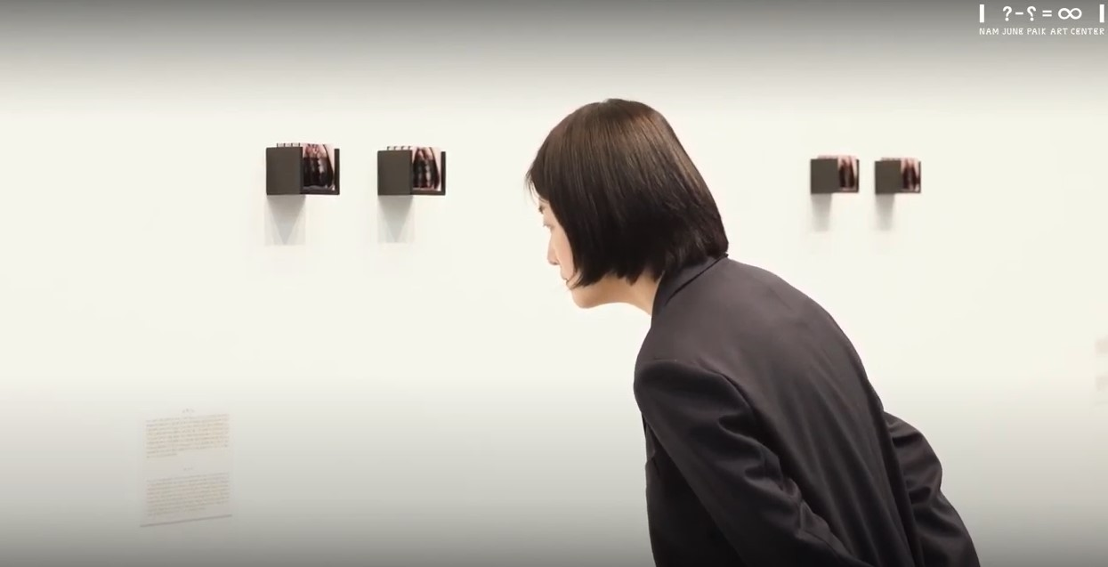 Curator Kim Yoon-seo gives a guided tour of the exhibition on YouTube video. (Screen shot from Gyeonggi Cultural Foundation's YouTube channel)