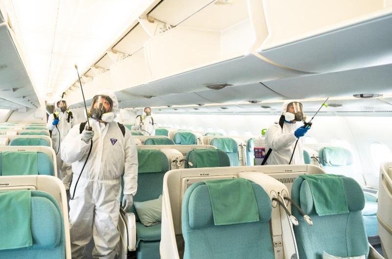 Korean Air officials conduct disinfection inside a flight. (Korean Air)