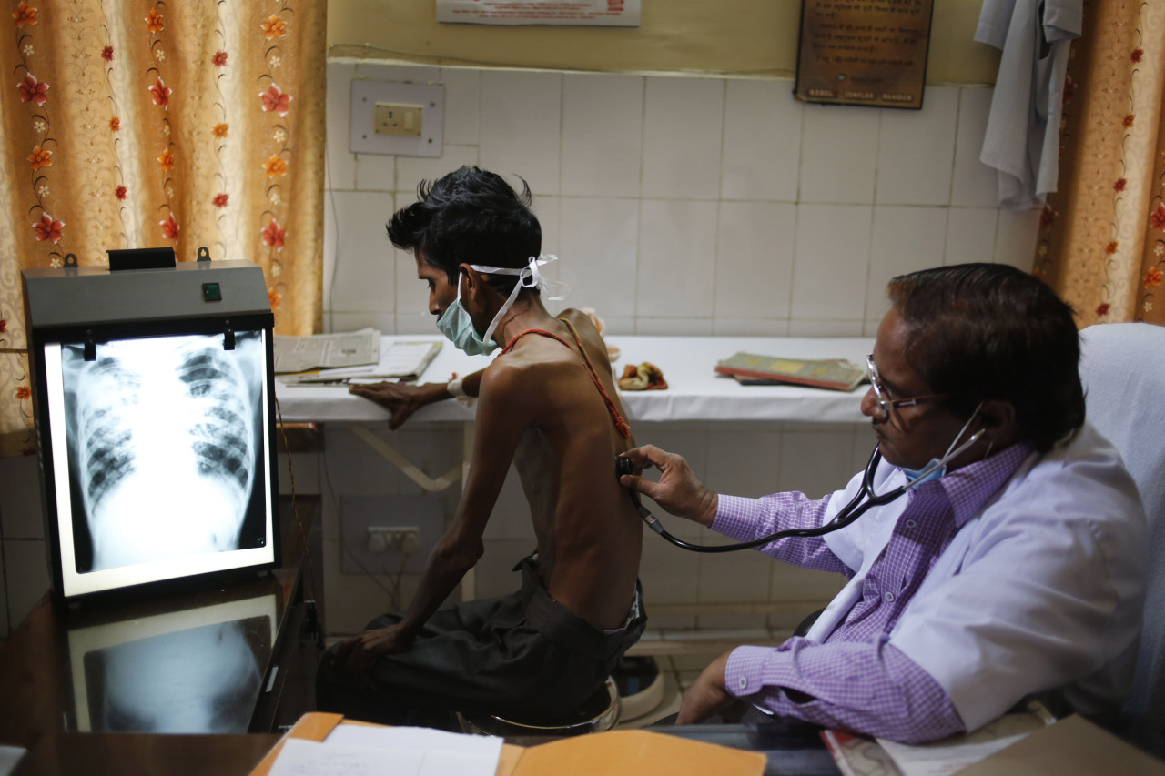 In this March 24, 2014, file photo, a doctor examines a tuberculosis patient in a government TB hospital in Allahabad, India. As the world focuses on the pandemic, experts fear losing ground in the long fight against other infectious diseases like AIDS, tuberculosis and cholera that kill millions every year. (AP-Yonhap)