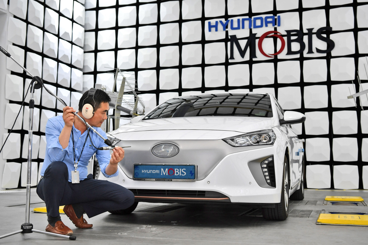 A Hyundai Mobis official tests the company's virtual engine sound system called Acoustic Vehicle Alert Sound. (Hyundai Mobis)