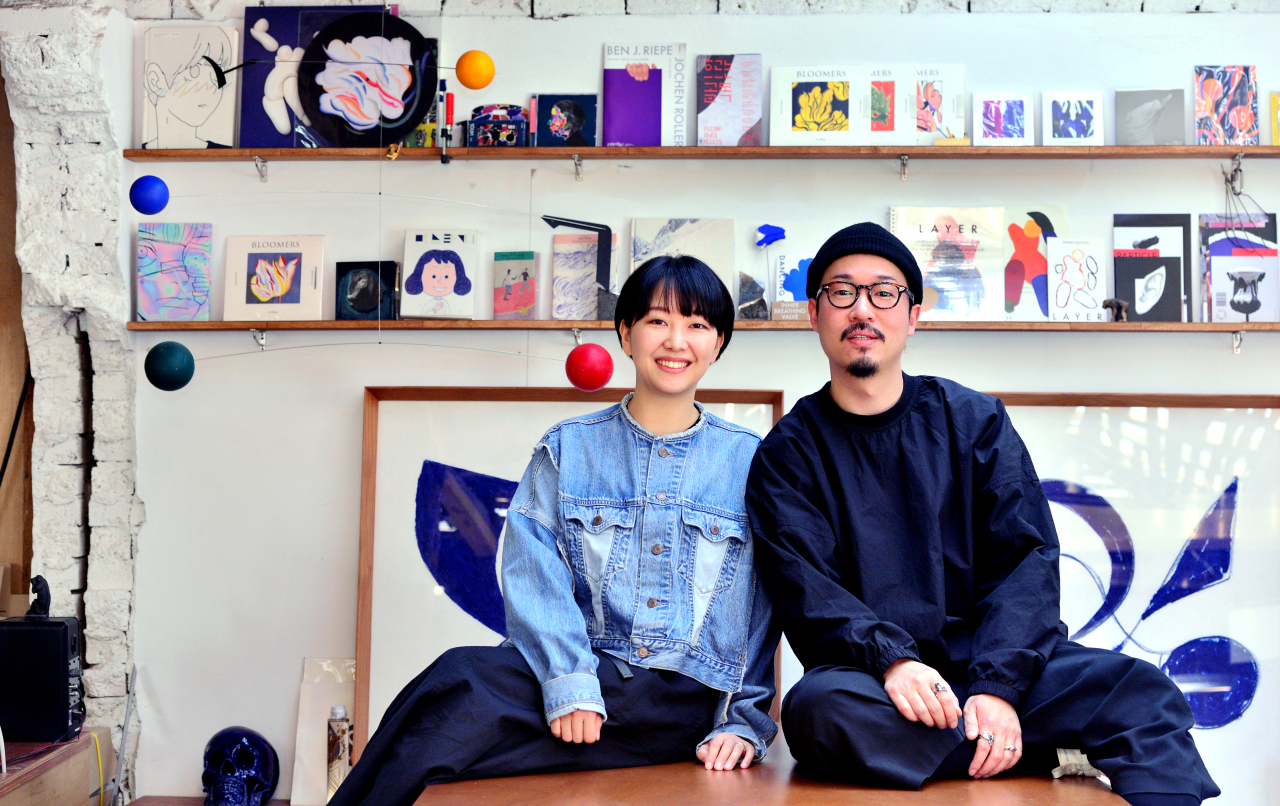 Designer duo and couple A ji-hye (left) and Jang joon-oh at their studio in Seoul (Park Hyun-koo/The Korea Herald)