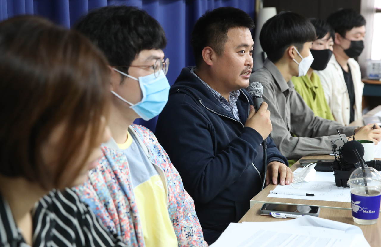 A member of one of seven pro-LGBT groups speaks during a joint press conference held to announce the launch of an emergency countermeasures headquarters in central Seoul on Tuesday. The groups vowed to help in Itaewon virus breakout. (Yonhap)