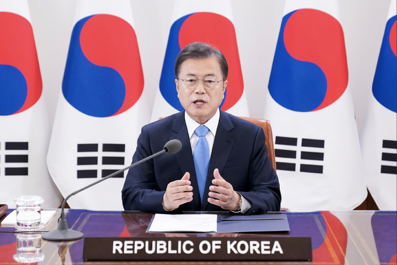 South Korean President Moon Jae-in delivers a pre-taped speech for the World Health Assembly's video session, played at a World Health Organization forum on Monday. (Yonhap)