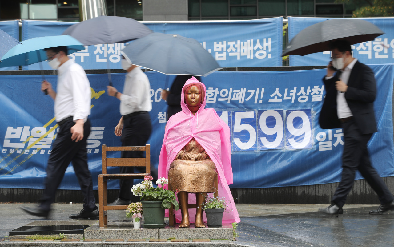 The bronze statue of a girl representing victims of Japanese World War II-era sexual slavery stands in front of the former site of the Japanese Embassy in Seoul. (Yonhap)