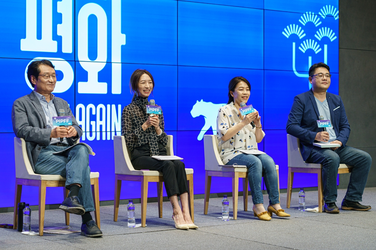 Chairman of the Pyeongchang International Peace Film Festival Moon Sung-keun (from left), festival director Pang Eun-jin and programmers Choi Eun-young and Kim Hyung-seok attend the official press conference on the festival held Tuesday. (PIPFF)