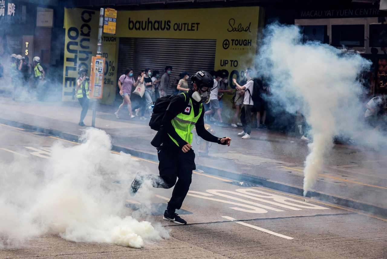 Police fire tear gas on protesters during a planned protests against a proposal to enact a new security legislation in Hong Kong on Sunday. (AFP-Yonhap)