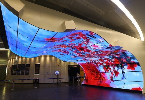 Organic light-emitting diode screens form curved display surfaces in commercial setting (LG Display)