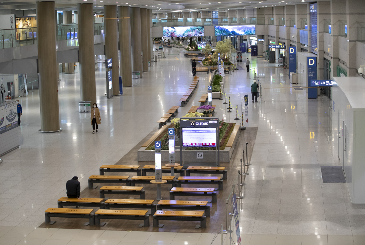 Incheon International Airport`s Terminal 1 stands vastly empty earlier this month amid ongoing fears of the coronavirus outbreak. (Yonhap)