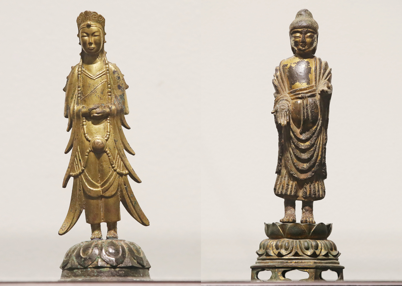 Treasure No. 285, Gilt-Bronze Standing Bodhisattva, (left) and Treasure No. 284, Gilt-Bronze Standing Buddha (Yonhap)