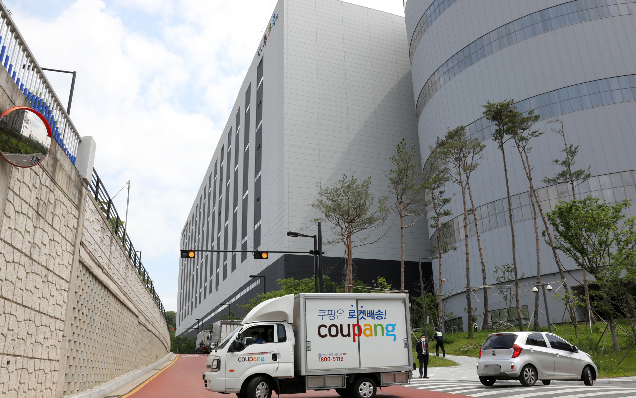 A Coupang delivery truck is parked in front of the company's logistics center in Goyang, Gyeonggi Province, Thursday. (Yonhap)