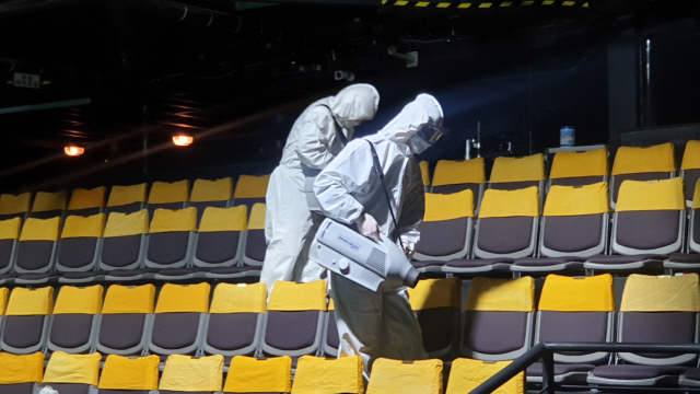 "Workers disinfect the Baek Seonghui & Jang Minho Theater in central Seoul before the National Theater Company of Korea performs ""Young-ji."" (NTCK)"