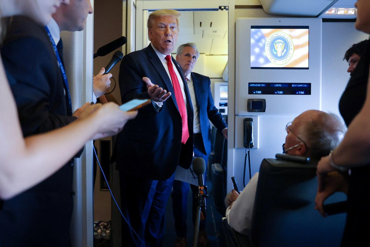 On Air Force One returning to Washington, US President Donald Trump tells reporters he will postpone the G-7 summit from late June to September and invite South Korea, Australia, India and Russia to discuss China. (Reuters-Yonhap)