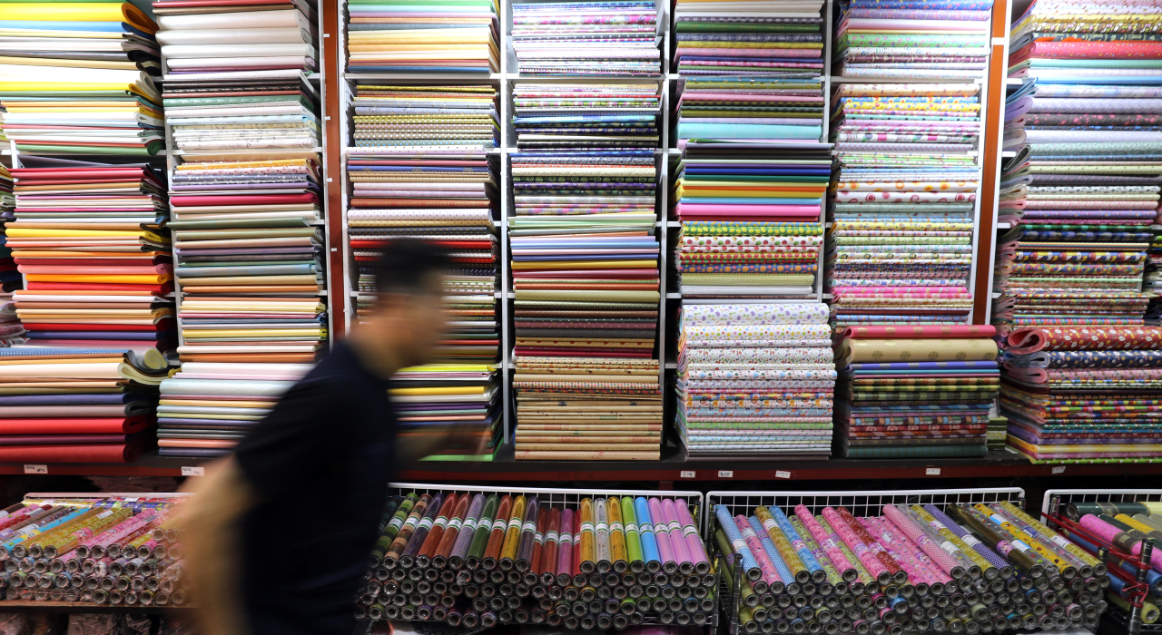 A shopper passes by a paper shop in Namdaemun market in Seoul on Wednesday. (Yonhap)