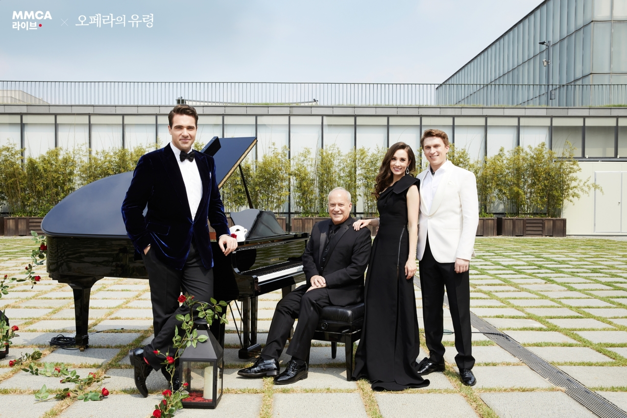 """From left: Jonathan Roxmouth playing the Phantom,Music Director David Andrews Roger, Claire Lyon playing Christineand Matt Leisy playing Raoul in """"The Phantom of the Opera"""" pose for photos in front of the MMCA Seoul in Samcheong-dong, central Seoul. (S&Co)"""