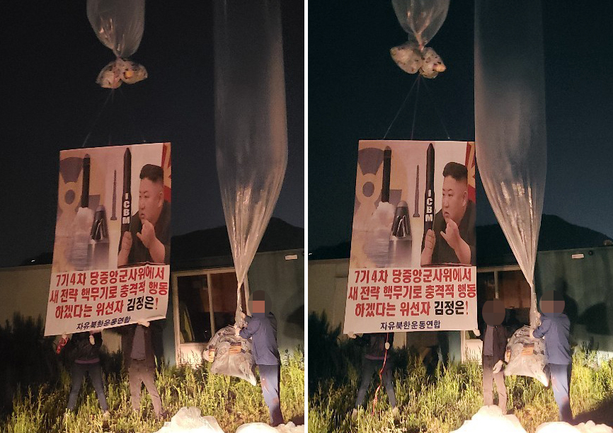 Members of Fighters for Free North Korea send balloons carrying anti-North leaflets across the border. (Yonhap)