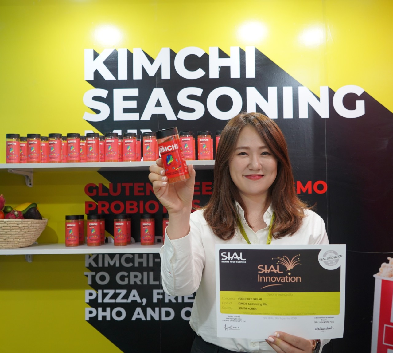 Sun An holds up her kimchi seasoning mix after winning an innovation award at a food expo in India in 2019. (Food Culture Lab)
