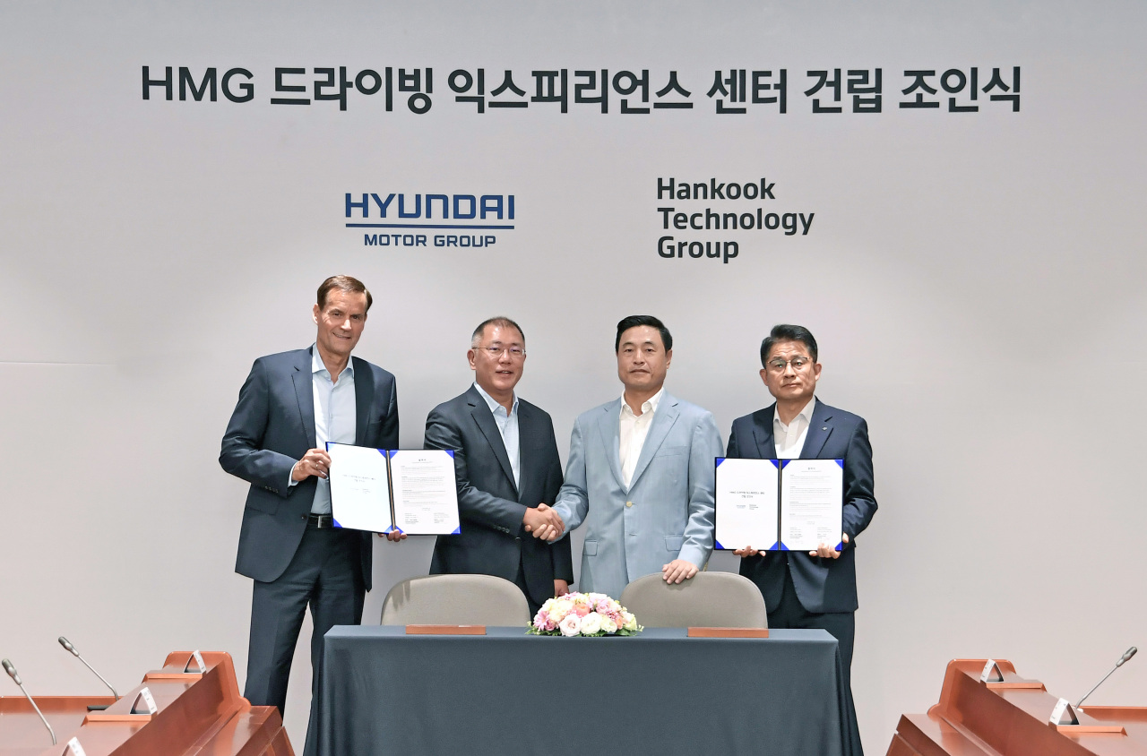 (From left) Thomas Schemera, head of the product division at Hyundai Motor Group; Hyundai Motor Group Executive Vice Chairman Chung Euisun; Hankook Technology Group Vice Chairman Cho Hyun-sik; and Hankook Tire and Technology President Lee Soo-il pose for a photo after clinching a joint partnership to establish the HMG Driving Experience Center in Seoul, Wednesday. (Hyundai Motor Group)