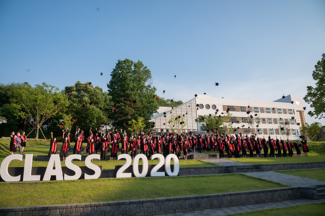 Students of Seoul Foreign School's Class of 2020 throw their graduation caps in the air at a graduation ceremony on May 29. Attendance at the ceremony was limited to the seniors themselves, their immediate family members and High School faculty to adhere to social distancing rules. (Seoul Foreign School)