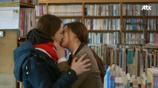 "Two high school girls kiss in a scene from JTBC's ""Seonam Girls High School Investigators"" (2014). (JTBC)"