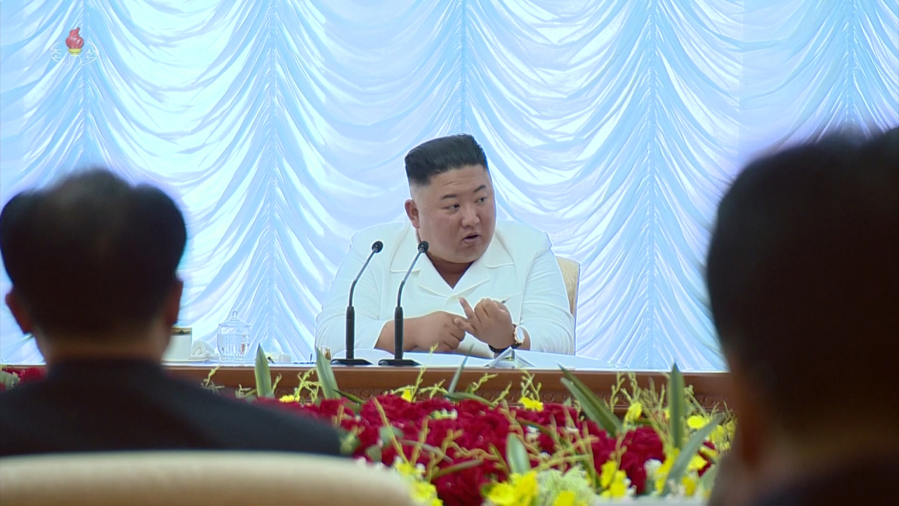 North Korean leader Kim Jong-un is seen speaking at a meeting held on June 7. (Yonhap)