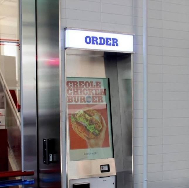 Customers can order burgers via the automated machine at the front of the restaurant. (Fault Burger)