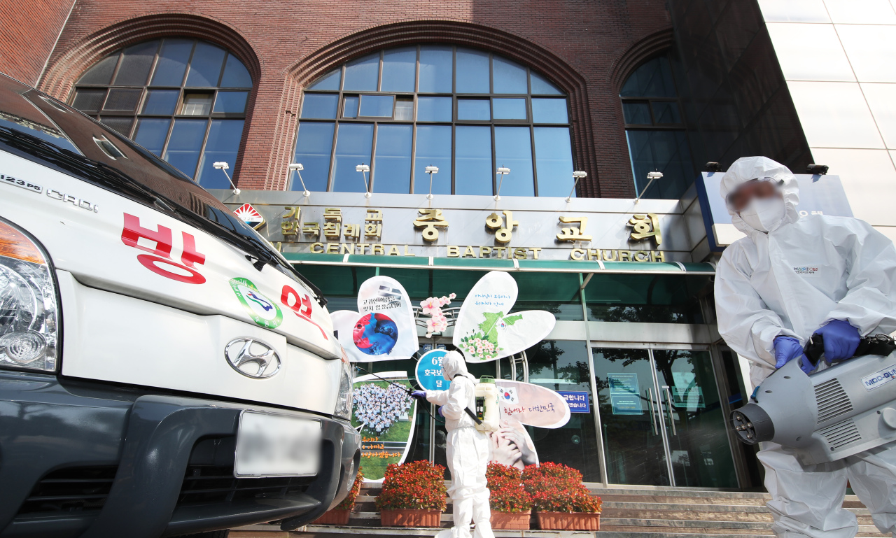 Health personnel disinfect a baptist church in Suwon, where at least three cases have been discovered as of Monday. (Yonhap)
