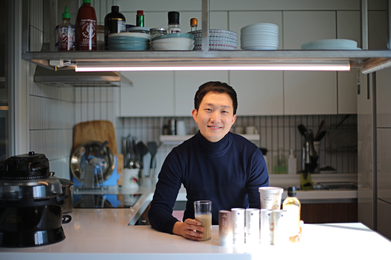 Lee Hyung-jin, CEO of My Normal, poses with bulletproof coffee (My Normal)