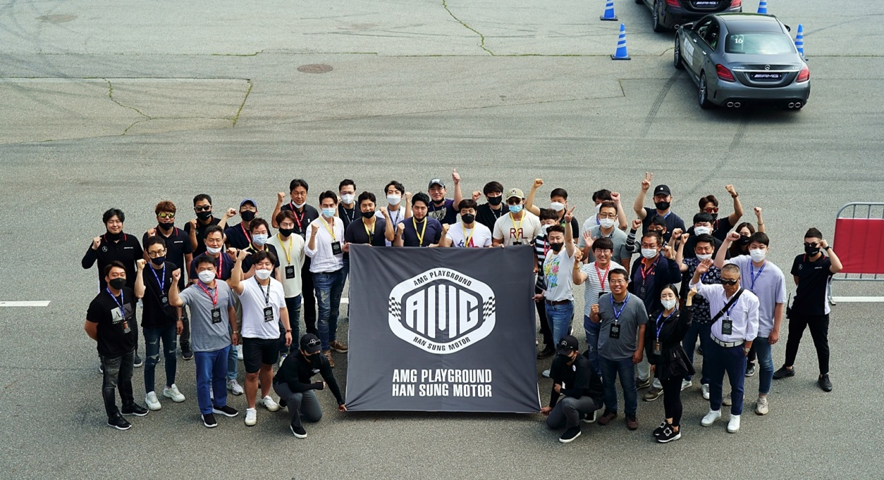 AMG Playground members pose for a photo after a launching ceremony held at AMG Speedway in Yongin, Gyeonggi Province on June 13. (Han Sung Motor)